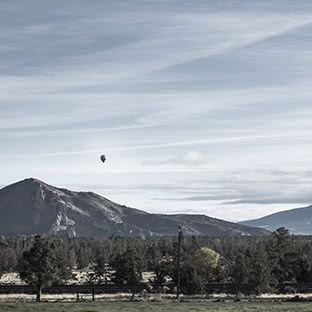 hot air balloon over mountains