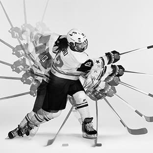 hockey player shooting puck