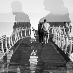 double exposure of people and boardwalk